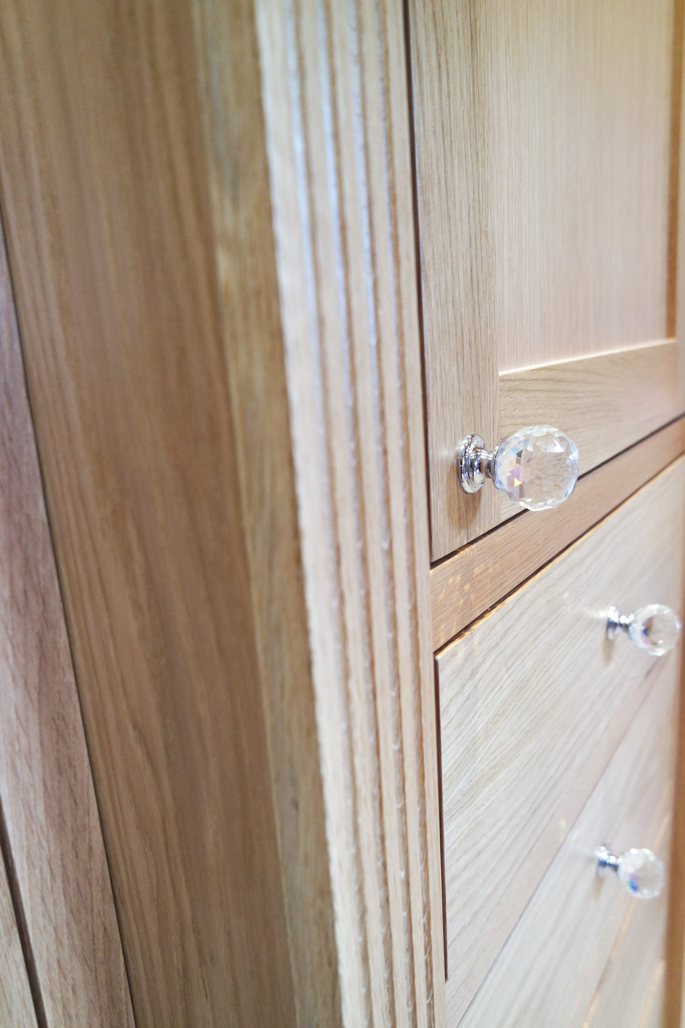 Fitted oak wardrobe with swarovski crystal knobs